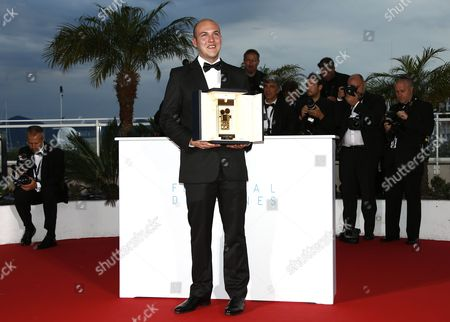 Stock Picture of Colombian Director Cesar Augusto Acevedo Poses with the Golden Camera Award For 'La Tierra Y La Sombra' During the Award Winners Photocall at the 68th Annual Cannes Film Festival in Cannes France 24 May 2015 France Cannes