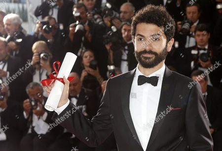 Lebanese Director Ely Dagher Poses with the Short Film Golden Palm For 'Waves '98' During the Award Winners Photocall at the 68th Annual Cannes Film Festival in Cannes France 24 May 2015 France Cannes
