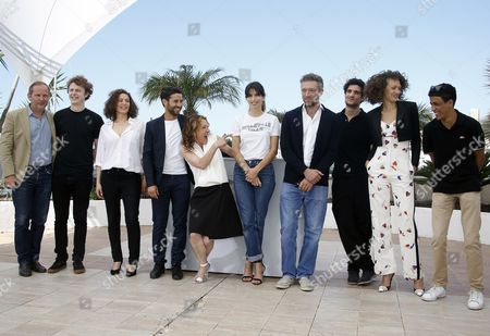 (l-r) French Screenwriter Etienne Comar French Actor Norman Thavaud French Actress Amanda Added French Actor Abdel Addala French Actress Emmanuelle Bercot French Director Maiwenn French Actor Vincent Cassel French Actor Louis Garrel French Actress Chrystele Saint Louis Augustin and French Actor Nabil Kechouhen Pose During the Photocall For 'Mon Roi' at the 68th Annual Cannes Film Festival in Cannes France 17 May 2015 the Movie is Presented in the Official Competition of the Festival Which Runs From 13 to 24 May France Cannes