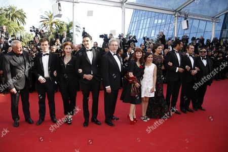 Screenwriter Gilles Taurand (l) Actor Gregoire Leprince-ringuet (2-l) Director Robert Guediguian (5-l) Actress Ariane Ascaride (6-l) Actress Razane Jammal (4-r) Actor Syrus Shahidi (3-r) Actor Robinson Stevenin (2-r) and Cast of 'Une Histoire De Fou' Arrive For the Screening of 'Youth' During the 68th Annual Cannes Film Festival in Cannes France 20 May 2015 the Movie is Presented in the Official Competition of the Festival Which Runs From 13 to 24 May France Cannes