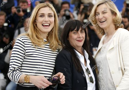 (l-r) French Actress and Producer Julie Gayet French Producer Sylvie Pialat and Russian Producer Nadia Turincev Pose During the Photocall For 'Comoara' (treasure) at the 68th Annual Cannes Film Festival in Cannes France 21 May 2015 the Movie is Presented in the Section Un Certain Regard of the Festival Which Runs From 13 to 24 May France Cannes