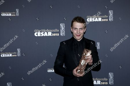 French Actor Kevin Azais Poses with His Best Newcomer Cesar Award For His Role in 'Les Combattants' in the Press Room During the 40th Annual Cesar Awards Ceremony Held at the Chatelet Theatre in Paris France 20 February 2015 France Paris
