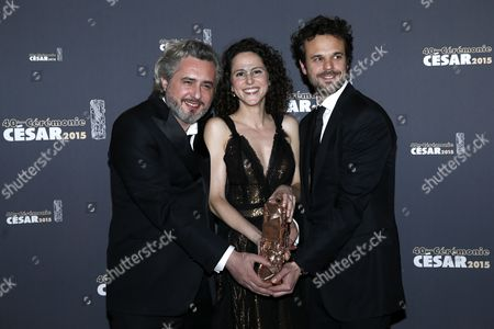 Stock Image of (l-r) French Directors Nicolas Rey Emma Luchini and Producer Romain Rousseau Pose with the Best Short Film Award For 'La Femme De Rio' in the Press Room During the 40th Annual Cesar Awards Ceremony Held at the Chatelet Theatre in Paris France 20 February 2015 France Paris