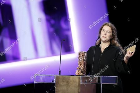 Stock Photo of Costume Designer Anais Romand Reacts After Receiving the Best Costumes Award For 'Saint Laurent' at the 40th Annual Cesar Awards Ceremony Held at the Chatelet Theatre in Paris France 20 February 2015 France Paris