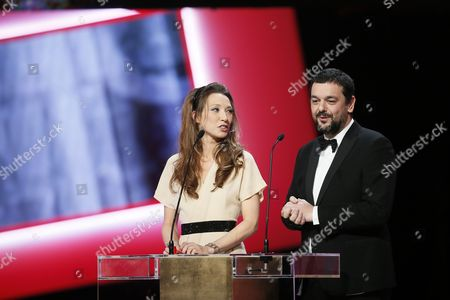 French Actress Laura Smet (l) and French Comic Artist and Filmmaker Joann Sfar Present the Best Animated Feature Award During the 40th Annual Cesar Awards Ceremony Held at the Chatelet Theatre in Paris France 20 February 2015 France Paris