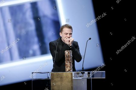 French Actor Kevin Azais Reacts After Receiving the Best Newcomer Cesar Award For His Role in 'Les Combattants' at the 40th Annual Cesar Awards Ceremony Held at the Chatelet Theatre in Paris France 20 February 2015 France Paris