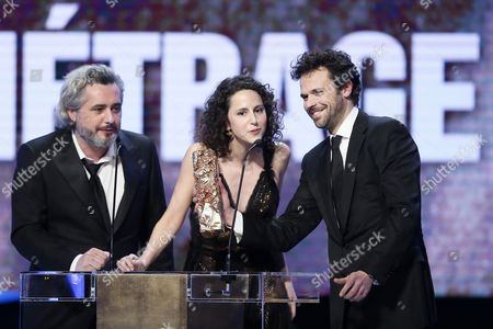 Stock Photo of (l-r) French Directors Nicolas Rey Emma Luchini and Producer Romain Rousseau Receive the Best Short Film Award For 'La Femme De Rio' During the 40th Annual Cesar Awards Ceremony Held at the Chatelet Theatre in Paris France 20 February 2015 France Paris