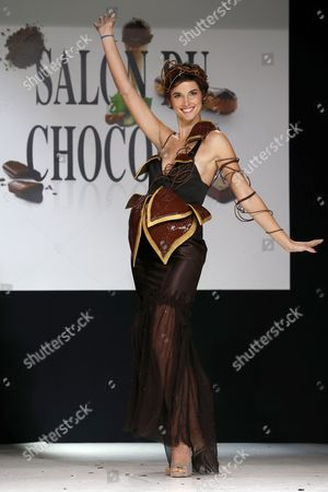 French Tv Presenter Eglantine Emeye Presents a Creation Made of Chocolate by Designer Maria Boyarovskaya and Chocolate Maker Jean-paul Hevin During a Fashion Show As Part of the Chocolate Fair in Paris France 29 October 2013 the 19th Salon Du Chocolat Runs From 30 to 03 November 2013 France Paris