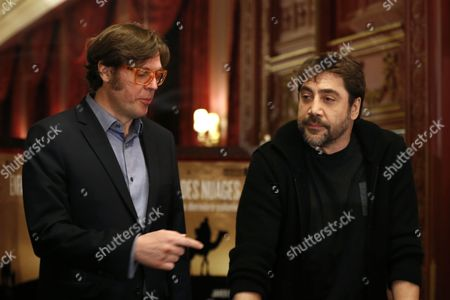 Spanish Actor Javier Bardem (r) Poses Next to Spanish Director Alvaro Longoria (l) During a Press Conference on Their Documentary Film 'Hijos De Las Nubes La Ultima Colonia' (sons of the Clouds: the Last Colony) in Paris France 18 February 2013 the Documentary Produced by Bardem and Directed by Longoria Looks at the Humanitarian Crisis in the Western Sahara That Has Left Nearly Nearly 200 000 People Living in Refugee Camps France Paris