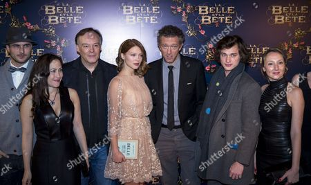 French Actors Lea Seydoux (c) Vincent Cassel (3-r) Louka Meliava (2-r) and Unidentified Crew Members Pose For the Photographers Prior to the Movie Premiere of the 'Beauty and the Beast' at the Gaumont Opera in Paris France 09 February 2014 France Paris