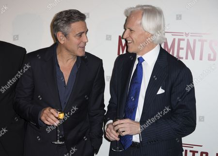 Stock Photo of Us Actor/cast Member and Director George Clooney (l) Talks with Us Writer Robert Morse Edsel (r) As They Pose For Photographers During the Premiere of 'The Monuments Men' in Paris France 12 February 2014 the Movie Opens in French Theaters on 12 March France Paris