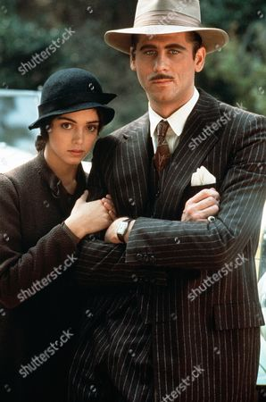 'Movie Movie'  Film - 1978 -    Angela Popchik (Kathleen Beller) holds on to the arm of Johnny Darko (Barry Bostwick), both are dressed in 1920's gangster type clothes.