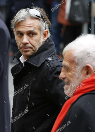 French Actor Jean-paul Belmondo (r) and His Son Paul Belmondo (l) Arrive at the Funeral of French Director Georges Lautner Held at the Cathedral of Sainte Reparate in Nice Southern France 30 November 2013 Georges Lautner Died Aged 87 in Paris France on 22 November 2013 France Nice