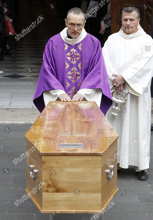 Stock Photo of The Coffin with the Remains of French Director Georges Lautner Stands Outside the Cathedral of Sainte Reparate During a Funeral Ceremony in Nice Southern France 30 November 2013 Georges Lautner Died Aged 87 in Paris France on 22 November 2013 France Nice