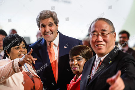 Us State Secretary John Kerry (c) Poses with Xie Zhenhua (r) China's Special Representative For Climat Change and Unidentified Members of Delegations Prior to the Plenary Session where the Final Agreement of the Cop21 is Presented the World Climate Change Conference 2015 (cop21) in Le Bourget North of Paris France 12 December 2015 the 21st Conference of the Parties (cop21) was Held in Paris From 30 November to 12 December France Le Bourget