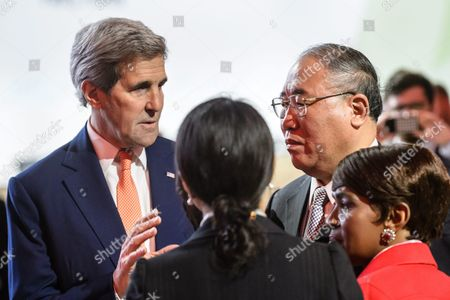 Us State Secretary John Kerry (c) Speaks with Xie Zhenhua (r) China's Special Representative For Climat Change and Unidentified Members of Delegations Prior to the Plenary Session where the Final Agreement of the Cop21 is Presented the World Climate Change Conference 2015 (cop21) in Le Bourget North of Paris France 12 December 2015 the 21st Conference of the Parties (cop21) was Held in Paris From 30 November to 12 December France Le Bourget