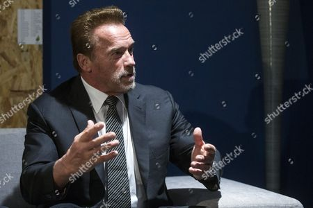 Former Us California Governor and Actor Arnold Schwarzenegger Talks During a Meeting with Austrian Environment Minister Andrae Rupprechter and French Foreign Affairs Minister Laurent Fabius (bpth not Pictured) During the Cop21 World Climate Change Conference 2015 in Le Bourget North of Paris France 08 December 2015 the 21st Conference of the Parties (cop21) is Held in Paris From 30 November to 11 December Aimed at Reaching an International Agreement to Limit Greenhouse Gas Emissions and Curtail Climate Change France Paris