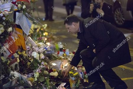 Latvian President Raimond Vejonis Lays Flowers to Pay Tribute to the Victims of 13 November Paris Terrorist Attacks in Front of Bataclan Convert Venue in Paris France 30 November 2015 Vejonis is Attending the 21st Conference of the Parties (cop21) Held in Paris From 30 November to 11 December Aimed at Reaching an International Agreement to Limit Greenhouse Gas Emissions and Curtail Climate Change France Paris