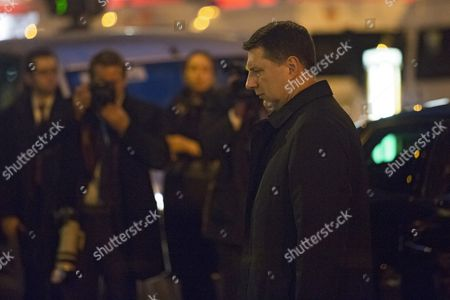 Stock Image of Latvian President Raimond Vejonis Lays Flowers to Pay Tribute to the Victims of 13 November Paris Terrorist Attacks in Front of Bataclan Convert Venue in Paris France 30 November 2015 Raimond Vejonisis Attending the 21st Conference of the Parties (cop21) Held in Paris From 30 November to 11 December Aimed at Reaching an International Agreement to Limit Greenhouse Gas Emissions and Curtail Climate Change France Paris