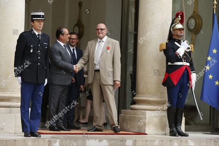 French President Francois Hollande (2-l) Greets British Businessman Chris Norman (c) After an Honorary Ceremony at the Elysee Palace in Paris France 24 August 2015 the Four Men who Stopped a Moroccan Citizen Ayoub El-khazzani who Opened Fire on a High-speed Thalys Train Travelling to Paris From Amsterdam Leaving at Least Two People Injured Were Awarded the Country's Legion D'honneur Medal France Paris