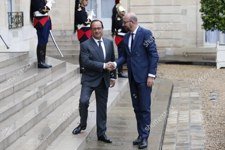 French President Francois Hollande (l) Welcomes Belgian Prime Minister Charles Michel (r) As He Arrives For a Ceremony to Award Us Serviceman Alek Skarlatos Us Serviceman Spencer Stone Us Student Anthony Sadler and British Consultant Chris Norman (non Pictured) at the Elysee Palace in Paris France 24 August 2015 the Four Men who Stopped a Moroccan Citizen Ayoub El-khazzani who Opened Fire on a High-speed Thalys Train Travelling to Paris From Amsterdam Leaving at Least Two People Injured Are Awarded the Country's Legion D'honneur Medal France Paris