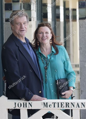 Us Director John Mctiernan (l) and His Wife Gail (r) Pose For Photographs After He Unveiled His Cabin Sign As a Tribute For His Career Along the Promenade Des Planches During the 40th Annual Deauville American Film Festival in Deauville France 08 September 2014 the Festival Runs From 05 to 14 September France Deauville
