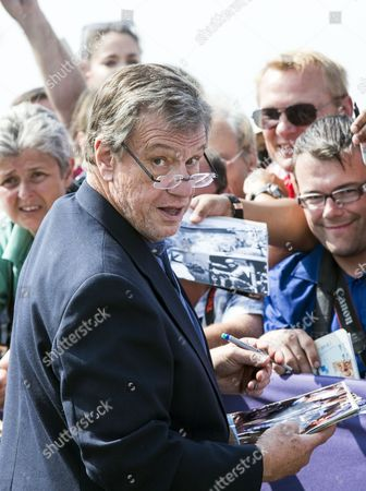 Us Director John Mctiernan Signs Autographs For Fans After He Unveiled His Cabin Sign As a Tribute For His Career Along the Promenade Des Planches During the 40th Annual Deauville American Film Festival in Deauville France 08 September 2014 the Festival Runs From 05 to 14 September France Deauville