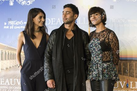 Iranian Film Director Ana Lily Amirpour (r) Us Actress/cast Member Sheila Vand (l) and Iranian Actor/cast Member Arash Marandi (c) Pose at a Photocall For a Girl Walk Home at Night During the 40th Annual Deauville American Film Festival in Deauville France 06 September 2014 the Movie is Presented in the Official Competition of the Festival That Runs From 05 to 14 September France Deauville