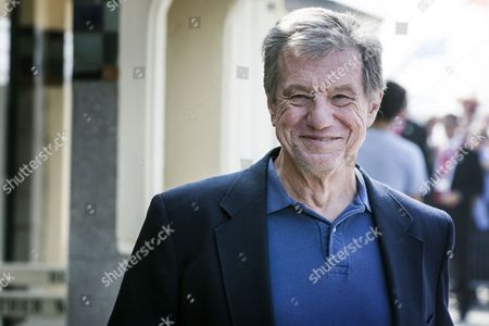 Us Director John Mctiernan Poses For Photographs After He Unveiled His Cabin Sign As a Tribute For His Career Along the Promenade Des Planches During the 40th Annual Deauville American Film Festival in Deauville France 08 September 2014 the Festival Runs From 05 to 14 September France Deauville
