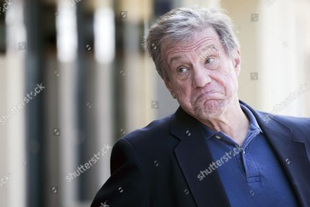 Stock Photo of Us Director John Mctiernan Poses For Photographs After He Unveiled His Cabin Sign As a Tribute For His Career Along the Promenade Des Planches During the 40th Annual Deauville American Film Festival in Deauville France 08 September 2014 the Festival Runs From 05 to 14 September France Deauville