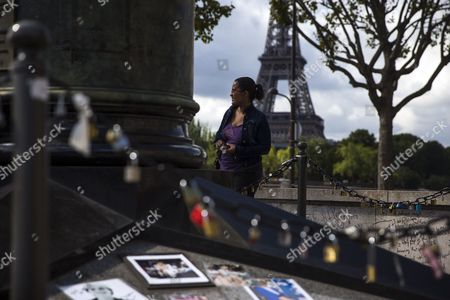 A Woman Stands in Front of a Longstanding Unofficial Memorial of Flowers and Pictures For Britain's Late Princess Diana on the Pont De L'alma Bridge in Paris France 31 August 2014 Today Marks the 17th Anniversary of the Fatal Car Crash That Killed Princess Diana and Her Companion Dodi Al-fayed in the Tunnel Beneath the Alma Bridge France Reims