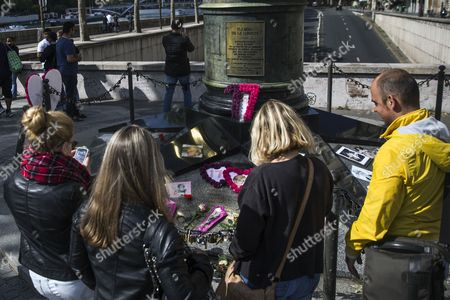 People Stand in Front of a Longstanding Unofficial Memorial of Flowers and Pictures For Britain's Late Princess Diana on the Pont De L'alma Bridge in Paris France 31 August 2014 Today Marks the 17th Anniversary of the Fatal Car Crash That Killed Princess Diana and Her Companion Dodi Al-fayed in the Tunnel Beneath the Alma Bridge France Reims