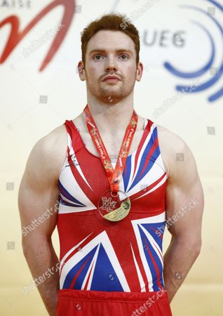 British Gymnast Daniel Purvis Celebrates His Bronze Medal on the Podium After the All-round Final at the Men's European Artistic Gymnastic Championships in Montpellier France 17 April 2015 the European Artistic Gymnastics Championships Which Take Place From 13 Through 19 April 2015 in Montpellier France Montpellier