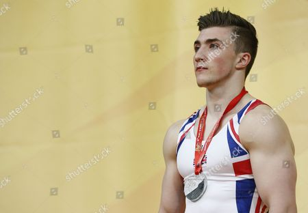 British Gymnast Sam Oldham Poses with His Second Place Silver Medal on the Podium After the Horizontal Bar Competition During the Men's Apparatus Final at the European Artistic Gymnastic Championships in Montpellier France 19 April 2015 France Montpellier
