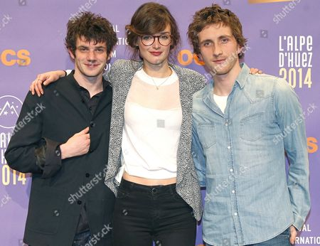 French Actors Felix Moati (l) Charlotte Le Bon (c) and Baptiste Lecaplain (r) Attend the Photocall For Their Movie 'Libre Et Assoupi' at the 17th Annual International Comedy Film Festival in L'alpe D'huez France 16 January 2014 the Festival Runs From 15 to 19 January France Alpe D'huez