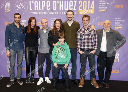 (l-r) French Actors Tarek Boudali Charlotte Gabris Julien Arruti Alice David Enzo Tomasini Vincent Desagnat Philippe Lacheau and Gerard Jugnot Attend the Photocall For Their Movie 'Babysitting' at the 17th Annual International Comedy Film Festival in L'alpe D'huez France 16 January 2014 the Festival Runs From 15 to 19 January France Alpe D'huez