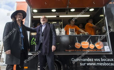 Triple Michelin-star Top French Chef Marc Veyrat (l) and President of Multi Restaurant Service (mrs) Gilles Terzakou (r) Pose For Photographs During an Initiative to Promote His New 'Eat Better Live Better' Food Truck in Paris France 04 February 2014 Veyrat's Initiative Intends to Offer High-end Ready-meal Cuisine For Office Workers' Lunch France Paris