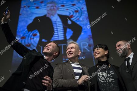 (l-r) Exhibition Curator Thierry Maxime Loriot French Fashion Designer Jean-paul Gaultier Director of the Montreal Museum of Fine Arts (mmfa) Nathalie Bondil and President of the Grand Palais Jean-paul Cluzel Pose For a Selfie After a Press Conference Ahead of the Media Opening of Gaultier's Retrospective Exhibition at the Grand Palais in Paris France 30 March 2015 Started by the Montreal Museum of Fine Arts in 2011 the Exhibition Which Has Toured in Cities Including Melbourne Madrid New York and London is Now in Its Tenth Leg and Will Run in Paris From 01 April to 03 August 2015 France Paris