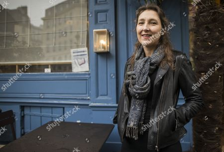 Stock Picture of French Author Marie Darrieussecq Poses After Being Awarded the Medicis Literary Prize For Her Book 'Il Faut Beaucoup Aimer Les Hommes' at the Mediterranee Restaurant in Paris France 12 November 2013 France Paris