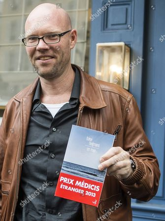 Dutch Author Toine Heijmans Poses After Being Awarded the Medicis Literary Foreign Prize For His Book 'En Mer' at the Mediterranee Restaurant in Paris France 12 November 2013 France Paris