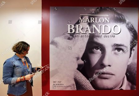 A Visitor Stands Near a Poster of a Documentary on 'Marlon Brando' at the International Audiovisual and Digital Content Market Miptv 2014 Held at the Festival Palace in Cannes France 07 April 2014 the Miptv Which Runs From 07 to 10 April is One of the World's Leading International Trade Events Dedicated to International Television Programs and to Digital Content and Interactive Entertainment For All Platforms France Cannes
