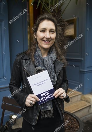 Stock Photo of French Author Marie Darrieussecq Poses After Being Awarded the Medicis Literary Prize For Her Book 'Il Faut Beaucoup Aimer Les Hommes' at the Mediterranee Restaurant in Paris France 12 November 2013 France Paris