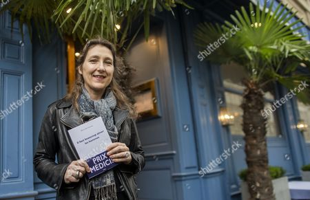French Author Marie Darrieussecq Poses After Being Awarded the Medicis Literary Prize For Her Book 'Il Faut Beaucoup Aimer Les Hommes' at the Mediterranee Restaurant in Paris France 12 November 2013 France Paris