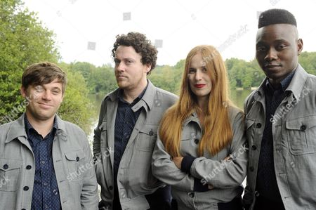 Stock Photo of A Photo Made Available 05 July 2014 of British Electro-pop Band 'Metronomy' with (l-r) Keyboarder Oscar Cash Leadsinger Joseph Mount Drummer Anna Prior and Bassist Gbenga Adelekan Posing For a Photo Call by the Lake at the 26th Eurockeennes Festival in Belfort France 04 July 2014 the Music Festival Runs From 04 to 06 July 2014 France Belfort