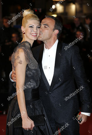 French Tv Host Nikos Aliagas (r) and His Wife Tina Grigoriou (l) Arrive to the 16th Nrj Music Awards at the Palais Des Festivals in Cannes France 13 December 2014 France Cannes