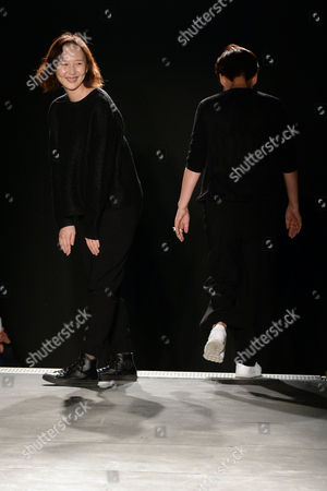 Stock Image of South Korean Designer Woo Young Mi(r) and Her Daughter Joint Creative Director Katie Chung (l) Leave the Catwalk After the Presentation of Their Fall/winter 2015/16 Men's Collection For Wooyoungmi During the Paris Fashion Week in Paris France 24 January 2015 the Presentation of the Men's Collections Runs From 21 to 25 January France Paris