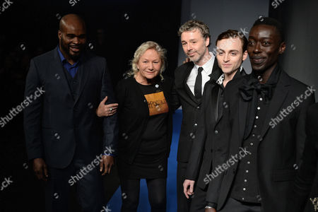 French Designer Agnes Trouble (2-l) Takes to the Catwalk with French Boxer Jean-marc Mormeck (l) British Singer Baxter Dury (c) French Actor Jules Pelissier (2-r) and Senegalese Photographer Omar Victor Diop (r) After the Presentation of Her Fall/winter 2015/16 Men's Collection For Her Label Agnes B During the Paris Fashion Week in Paris France 25 January 2015 the Presentation of the Men's Collections Runs From 21 to 25 January France Paris