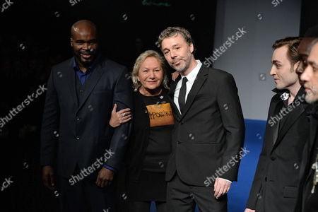 French Designer Agnes Trouble (2-l) Takes to the Catwalk with French Boxer Jean-marc Mormeck (l) British Singer Baxter Dury (2-r) French Actor Jules Pelissier (r) After the Presentation of Her Fall/winter 2015/16 Men's Collection For Her Label Agnes B During the Paris Fashion Week in Paris France 25 January 2015 the Presentation of the Men's Collections Runs From 21 to 25 January France Paris