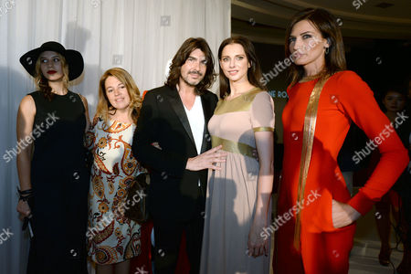 Stock Image of French Designer Stephane Rolland (c) Poses with Filmmaker Diane Sagnier (l) French Actress Frederique Bel (2-r) Spanish Model Nieves Alvarez (r) and Unidentified Woman During the Presentation of His Haute Couture Fall-winter 2014/15 Collection During the Paris Fashion Week in Paris France 08 July 2014 the Presentation of the Haute Couture Collections Runs From 6 to 11 July France Paris