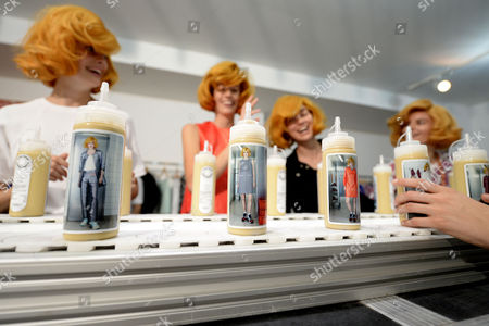 Models Look at Bottles Showing the Same Creations of the Collection From the Spring/summer 2015 Ready to Wear Collection by Belgian Fashion Designer Jean-paul Lespagnard That They Are Presenting During the Paris Fashion Week in Paris France 28 September 2014 the Presentation of the Women's Collections Runs From 23 September to 01 October France Paris